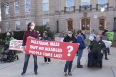 """Protestors - large banner """"Waltham, Mass. Why do disabled people come last?"""""""