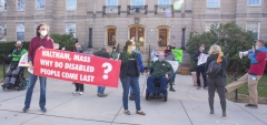 """Protestors - large banner """"Waltham, Mass. Why do disabled people come last?"""" , Bill Henning speaking."""