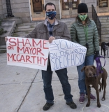 """Protestors and dog: """"Shame on Mayor McCarthy"""", """"You're on the Wrong Side of History"""""""