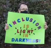 Protestor: Inclusion is Light in Darkness