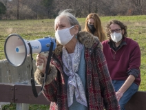 Ruthie Poole speaks to protestors at Fernald