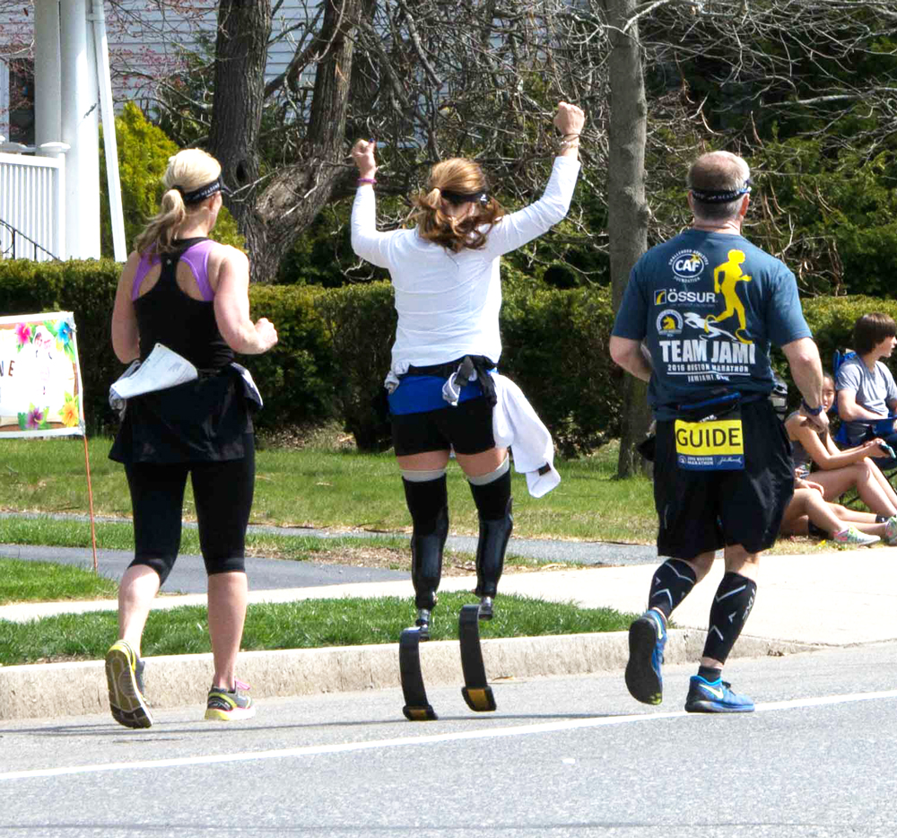Young woman with two blade legs in 2016 boston marathon cheering