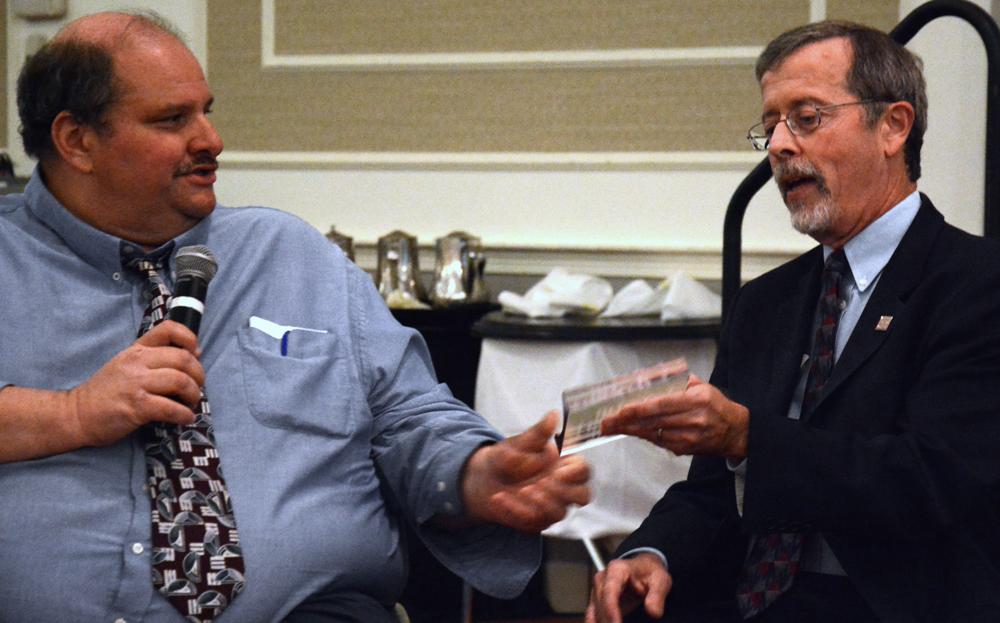 Kirk gets award from Joe Bellil